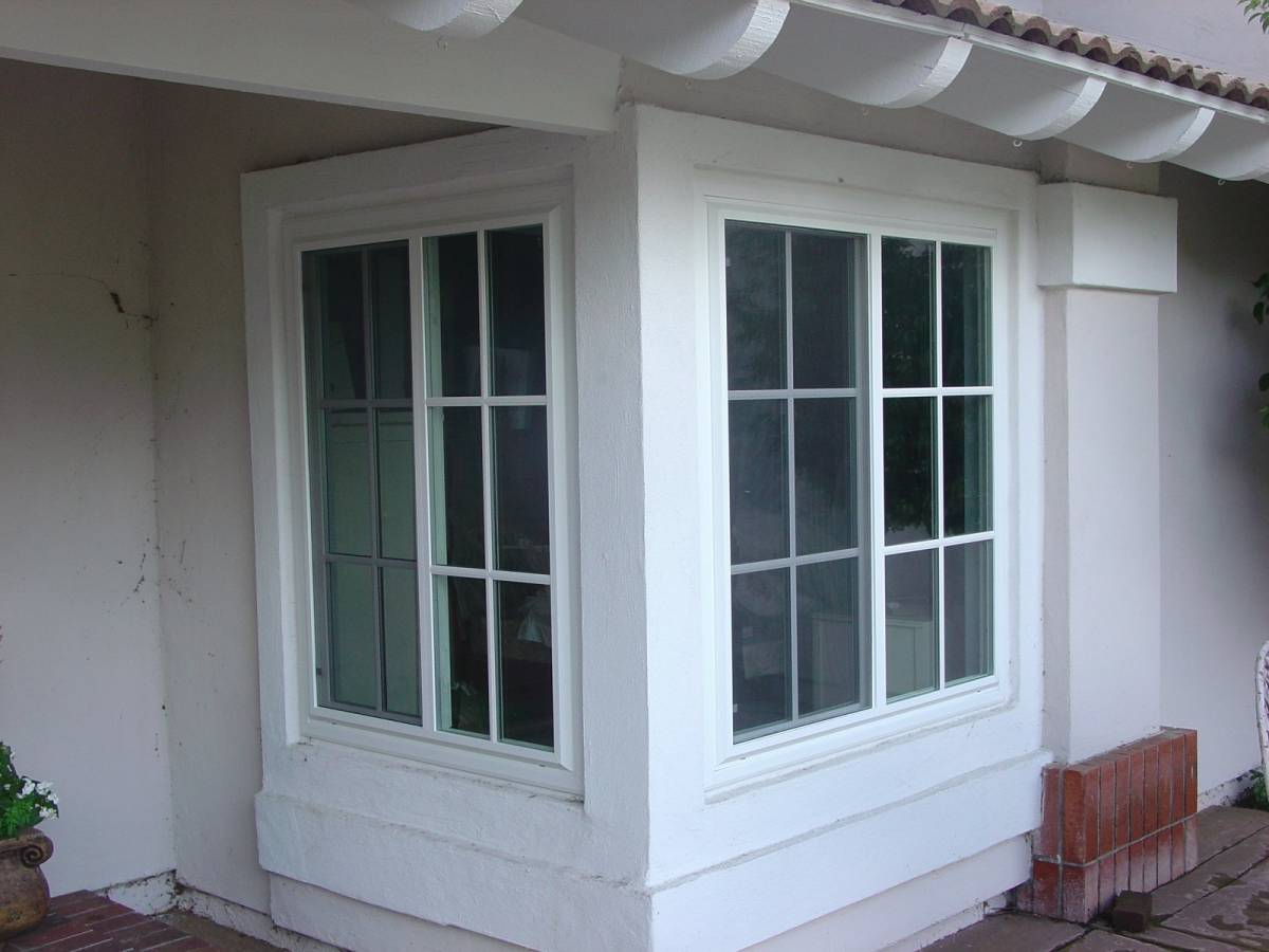 Photo gallery gallery sliding window with gird for Sliding glass windows