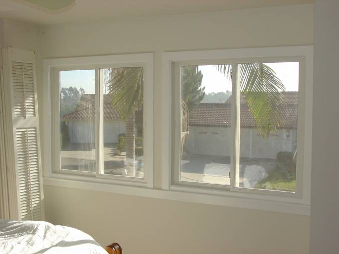 Vinyl Retrofit sliding window with 2 locks.